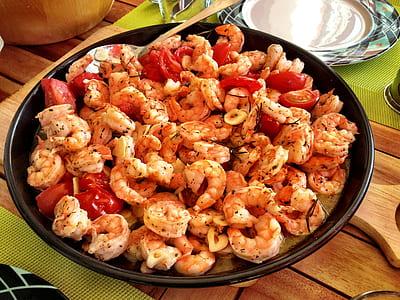 fried shrimps on black ceramic plate