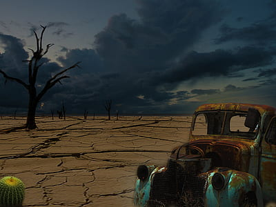 rusty vehicle near tree during cloudy sky