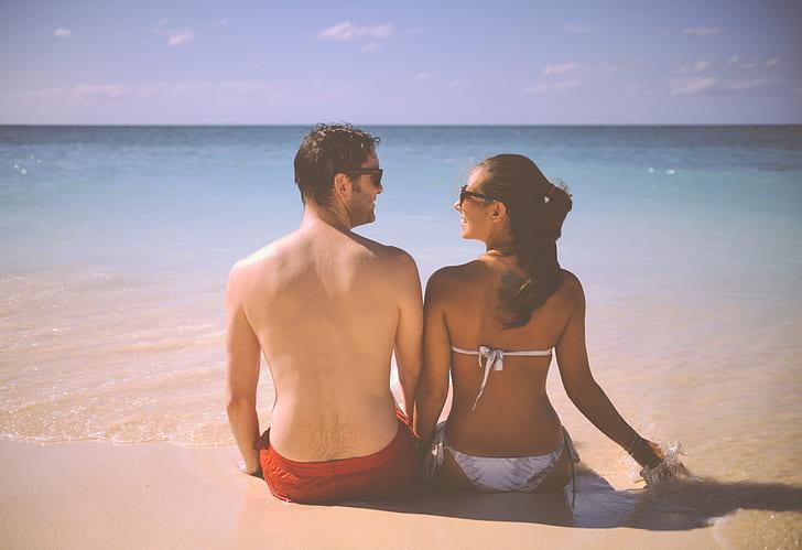 couple sitting on the seashore