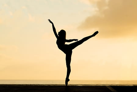 silhouette of woman doing ballet