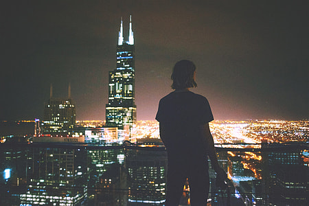 A man enjoying the view across the city at night