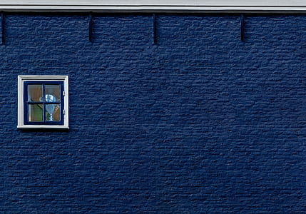 blue concrete wall with window