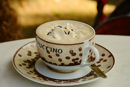 selective focus photography of cappuccino inside teacup
