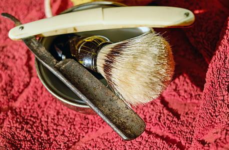 beige handle straight razor