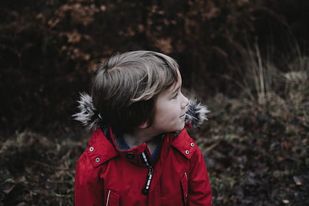 photograph of boy in red jacket