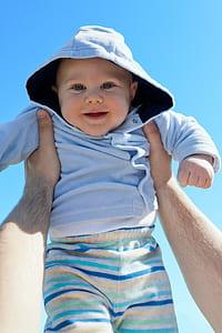 baby in blue hoodie