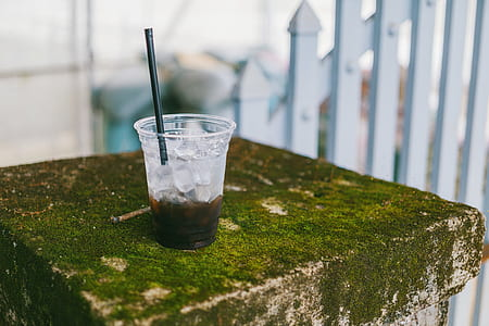 Disposable Cup With Black Beverage