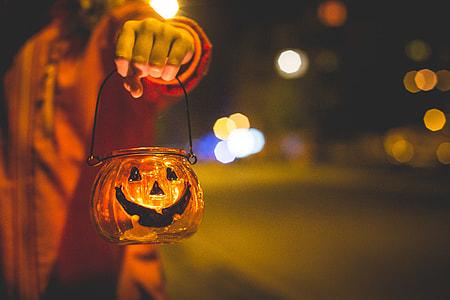 Little Girl Holding Halloween Candle Holder