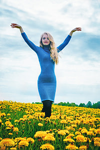 woman in blue turtleneck long-sleeved dress and black pants