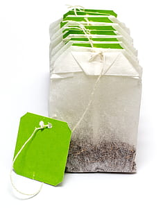 white and green tea bag