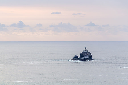 lighthouse in the middle of the sea