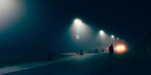 man walking in street photography