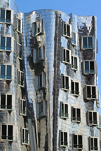 silver concrete building with windows opened