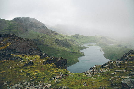 landscape photo of lake covered with fogs