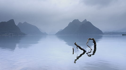 photo of a body of water and mountain
