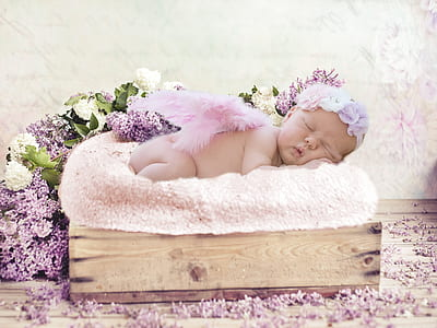 sleeping baby on top of white pad