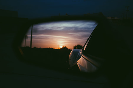 sunset reflect on car side mirror