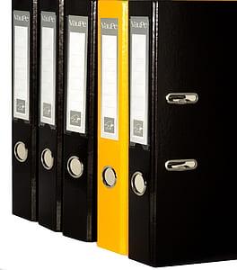 five black and brown binders