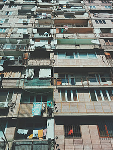 low angle photography of concrete residential buildings during daytime