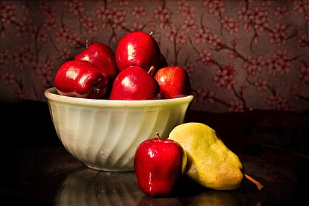 red apples and yellow pear
