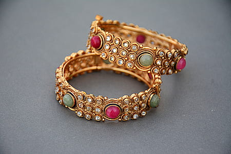 two gold-colored bracelets