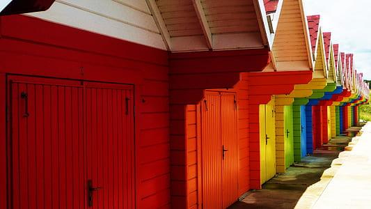 assorted-color wooden garages at daytime