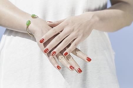 woman wearing gold-colored cuff bracelet