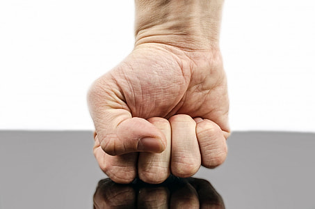 person's right fist on black surface