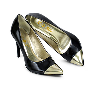 pair of black-and-gold leather pointed-toe stiletto shoes