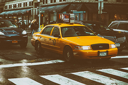 Street shot of a classic yellow taxi in Manhattan, New York City, image captured with a Canon 5D