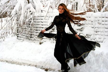 woman in black abaya dress on
