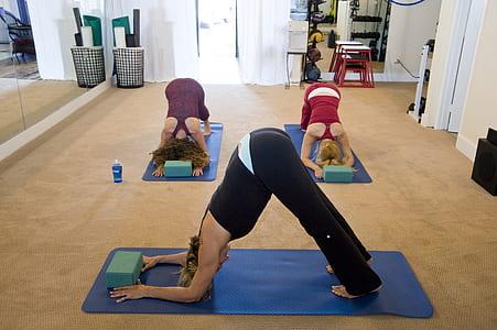 three women doing yoga