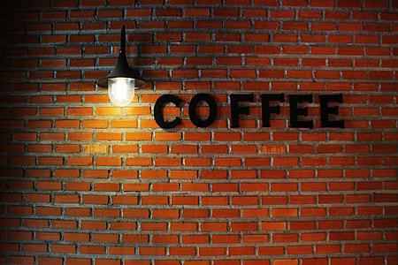 coffee signage on brown concrete wall blocks