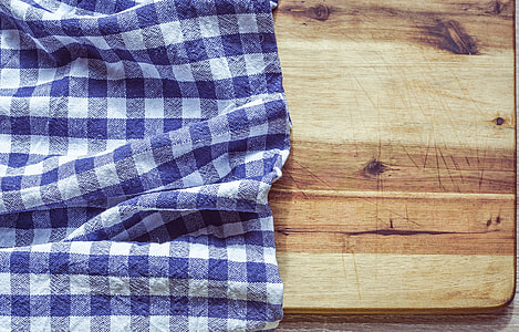 white and blue plaid cloth on brown surfacew