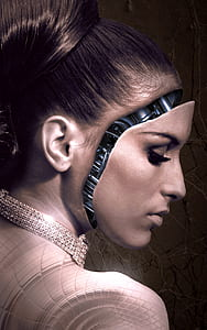 woman with robot face wearing gold-colored necklace