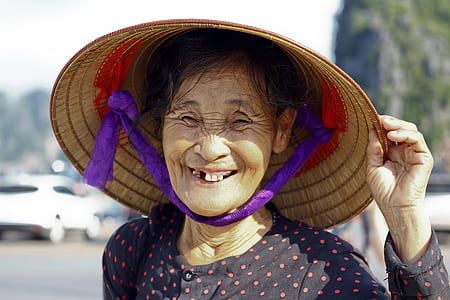 woman wearing brown wicker hat showing smile