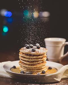 brown pancakes on white ceramic plate