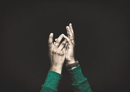 person's hand with black background