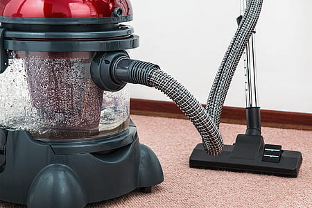 red and black wet/dry vacuum cleaner