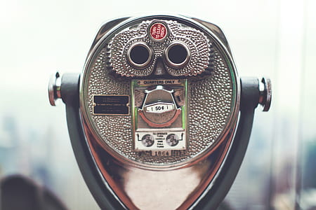 selective focus photography of coin-slot binocular
