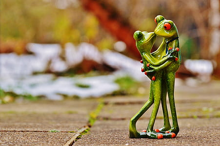 two green frog ceramic figures