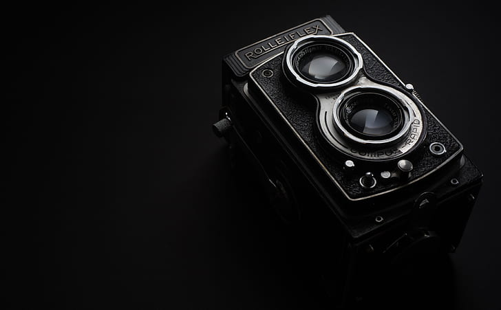 black and gray camera with black background