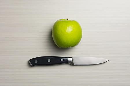Green Apple Beside Silver Bladed Knife