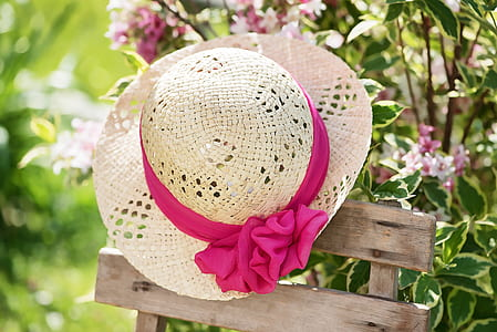 brown straw hat with pink bow accent