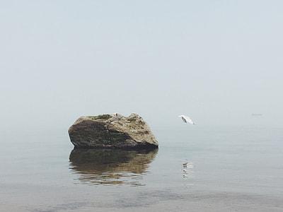 rock mono-lift surrounding body of water