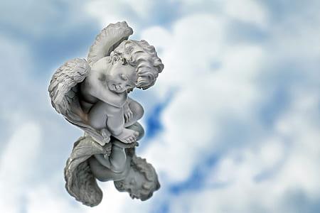 sleeping cherub statuette