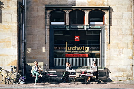 photo of three people sitting in front of Ludwig coffee