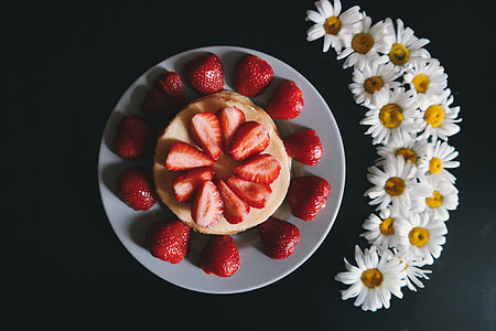 Overhead shot of strawberries and flowers
