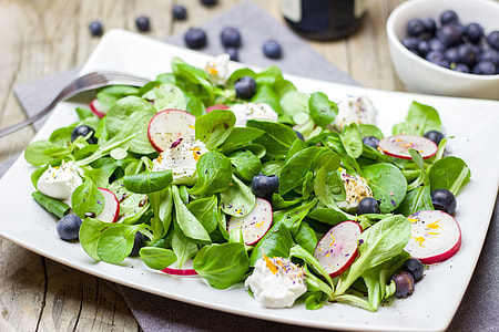 slices of blueberries, dragon fruit and green leafy vegetables