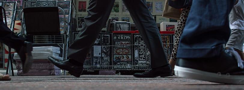 people wearing shoes walking on street